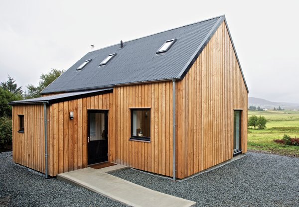 """It's a beautiful part of the world,"" says architect Alan Dickson about Scotland's Isle of Skye. ""The downside of that beauty is that land is expensive and very difficult for young people to afford, so they're leaving the island."" In 2010, Dickson, of the Skye-based firm Rural Design, and local builder James MacQueen came up with a solution: a small timber-frame prefab design called the R.House, which can be constructed quickly and tucked onto less expensive lots that don't appeal to well-heeled holiday homeowners.  Photo by Marcus McAdam."