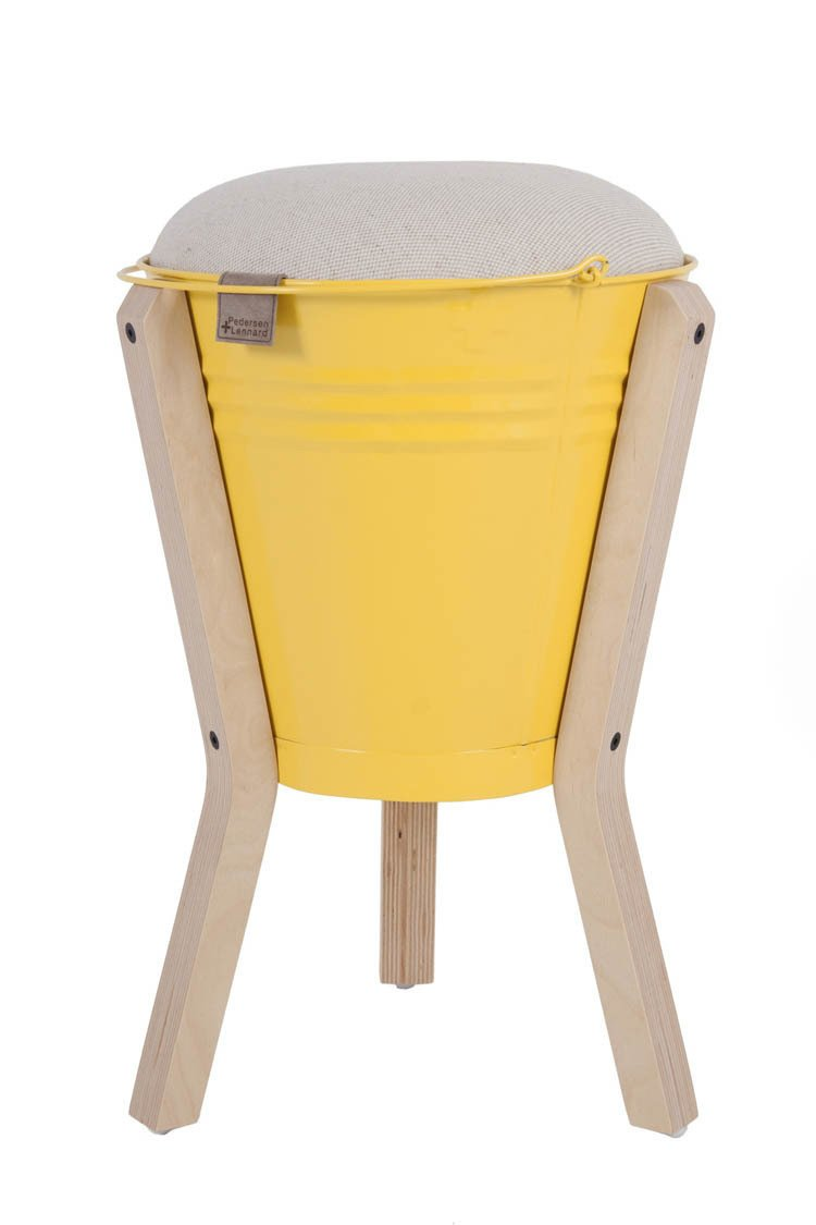 "Introduced in 2008, the Bucket Stool ""was inspired by our desire to combine handmade and precision-cut elements, as this best describes the juxtaposition of craft and design in South Africa,"" Pedersen says. ""The buckets are handmade in townships around Cape Town by craftsmen who have been working with sheet metal for generations. Each bucket is cut out by hand and hammered into shape with the most basic and ingenious of systems, along with our plus-sign logo. The legs and seat are CNC-cut from Scandinavian birch plywood, and the seat flips over to function as a side table. We have two models, a regular stool and a barstool.""  Photo 3 of 16 in Two Cool Surfers Design Some Serious Furniture"