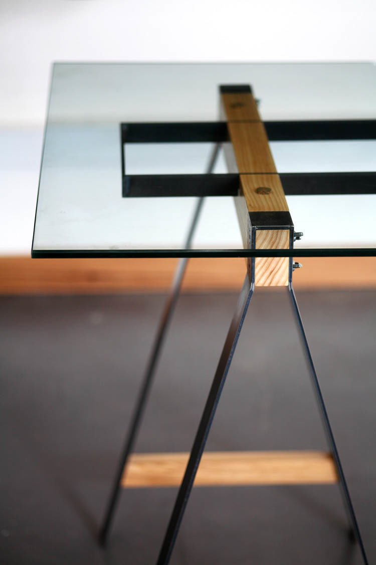 "The Glass Trestle table ""explores the relationship between steel and wood to complement each other in a way that each material is intrinsically weak without the other,"" Pedersen says. ""The wood is clamped between the steel, which in turn holds the structural steel that supports the weight of the glass as it spans. The manufacturing process interests us a lot as the parts are individually cut out and welded together, but the strength only comes when the parts are assembled. We've done a range of sizes for this table, from a small home office desk to a larger boardroom table.""  Photo 15 of 16 in Two Cool Surfers Design Some Serious Furniture"