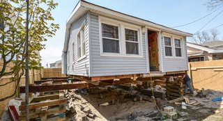 In Breezy Point, Queens, one of the communities hit hardest by Superstorm Sandy, Azaroff's +LAB architects raised a damaged home to avoid future floodwater.