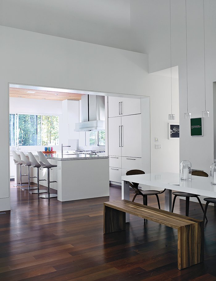 Kitchen, White Cabinet, and Marble Counter Bates Masi designed the two-inch-thick Carrara marble countertops and white fiberboard cabinetry in the kitchen.  Photo 5 of 12 in Art-Filled Hamptons Vacation Home