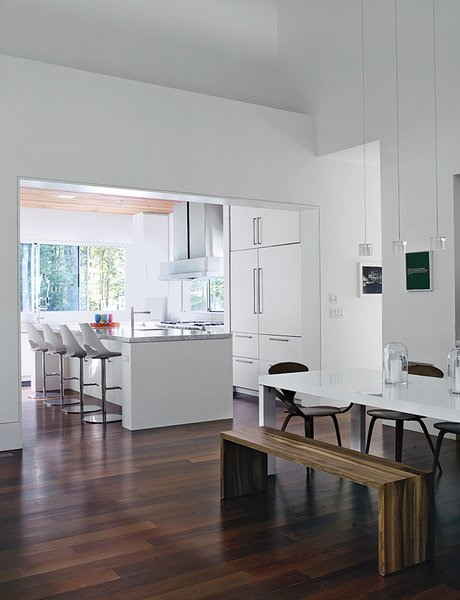 Bates Masi designed the two-inch-thick Carrara marble countertops and white fiberboard cabinetry in the kitchen.