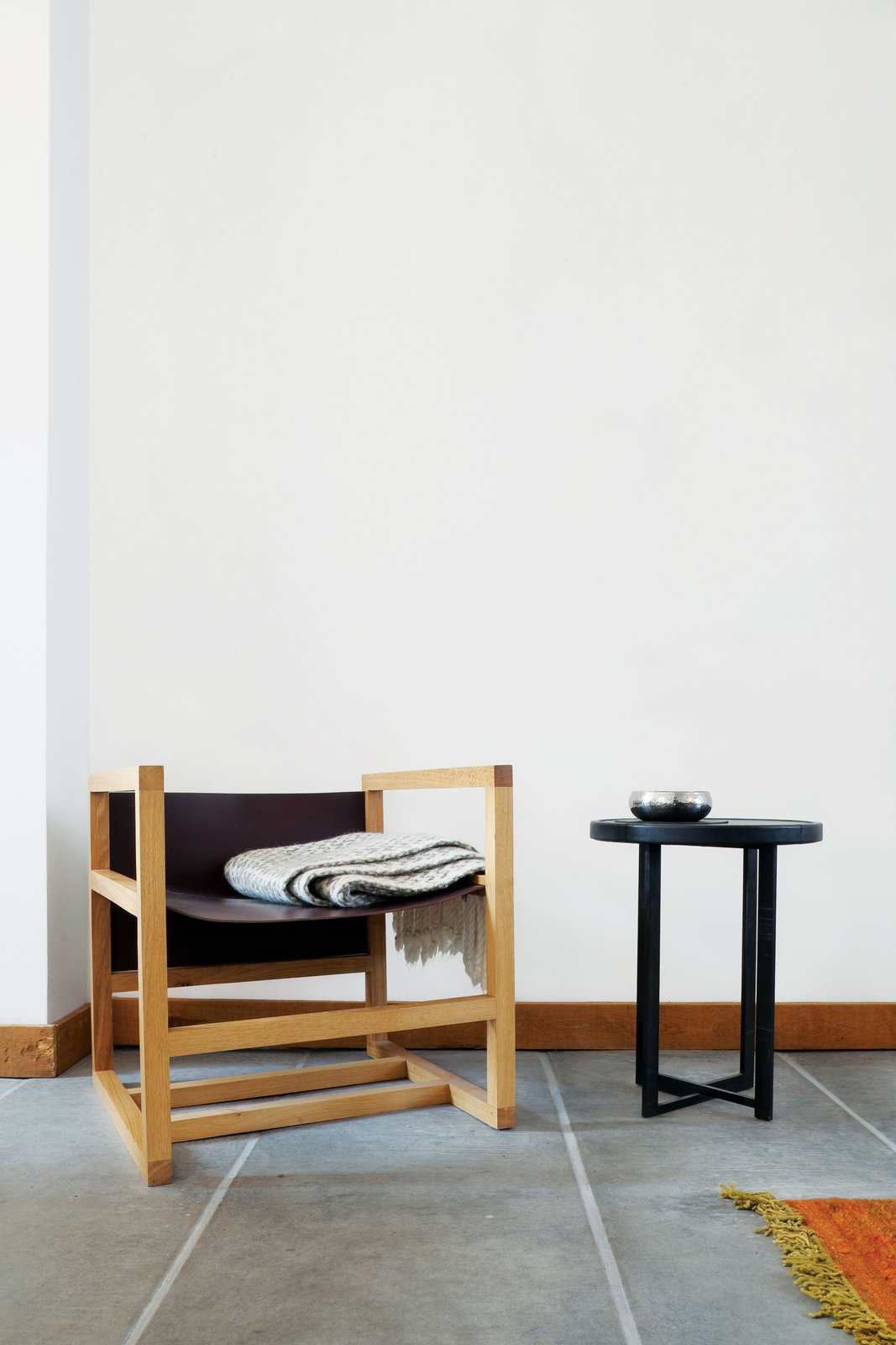 One corner holds a chair and table designed by Verheyden.  Photo 6 of 8 in A Clever Belgian Couple Renovate Their Aging Brick Home