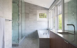 Interior walls were repainted and flooring was repaired, but the master bathroom received the most attention in the existing house. The renovation included marble mosaic floor tiles, fixtures by Blu Bathworks, and Silestone countertops.