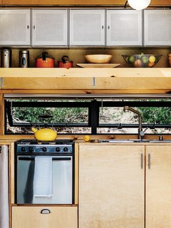 Container Store finds, like galvanized-steel shelving in the kitchen, maximize storage.