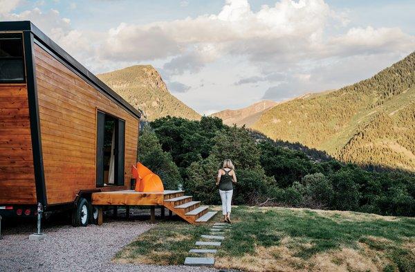 Woody camper trailer exterior in hillside landscape