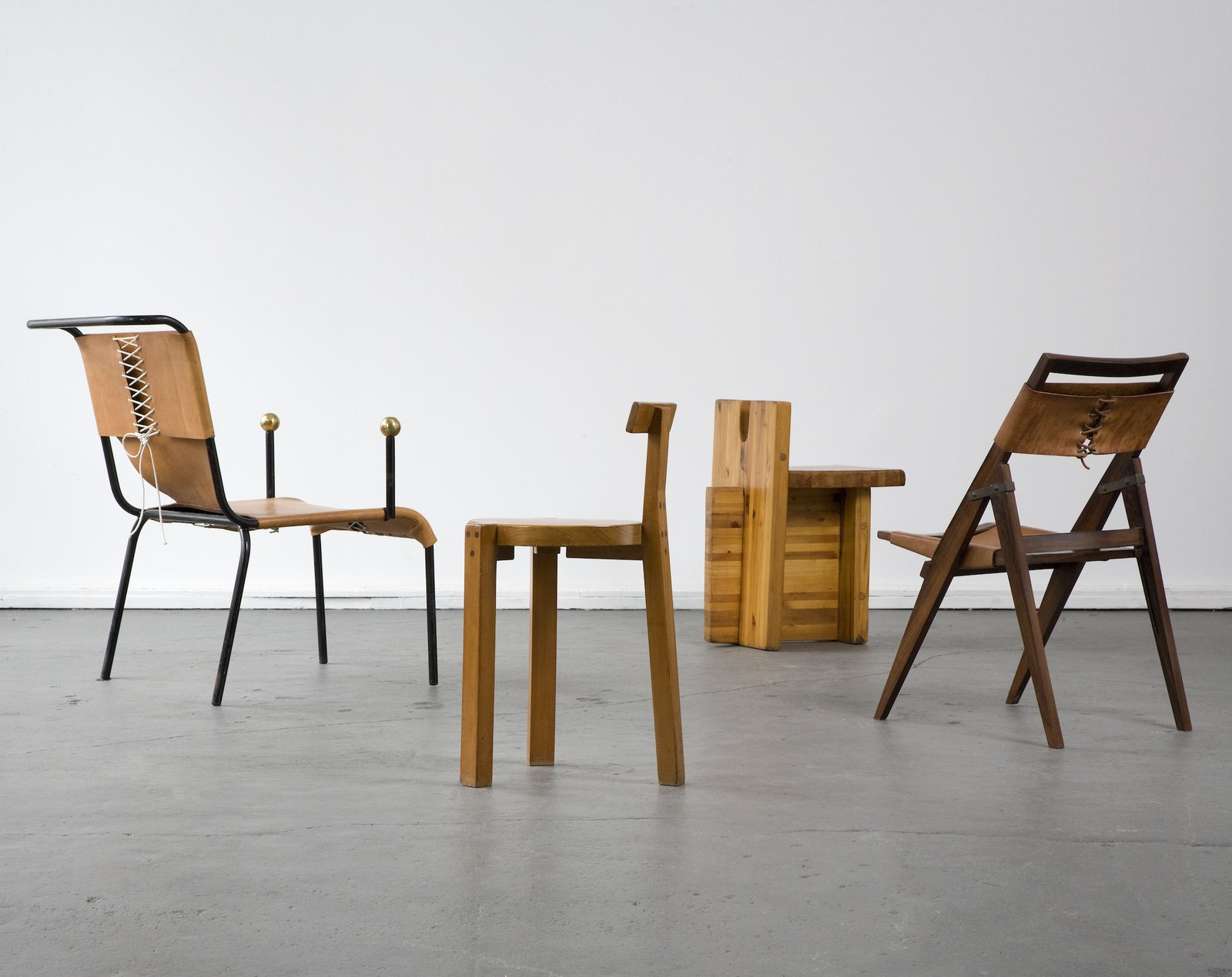 Architect Lina Bo Bardi embraced the vernacular design traditions while pushing new forms forward. Her use of not only wood but fabrics and leathers stand out in several of her designs. Her furniture was often designed only for her buildings. This group of chairs was created between the 1950s and the 1980s.  100+ Best Modern Seating Designs from Bring the Best of Brazilian Modernism to Your Home with This New Book