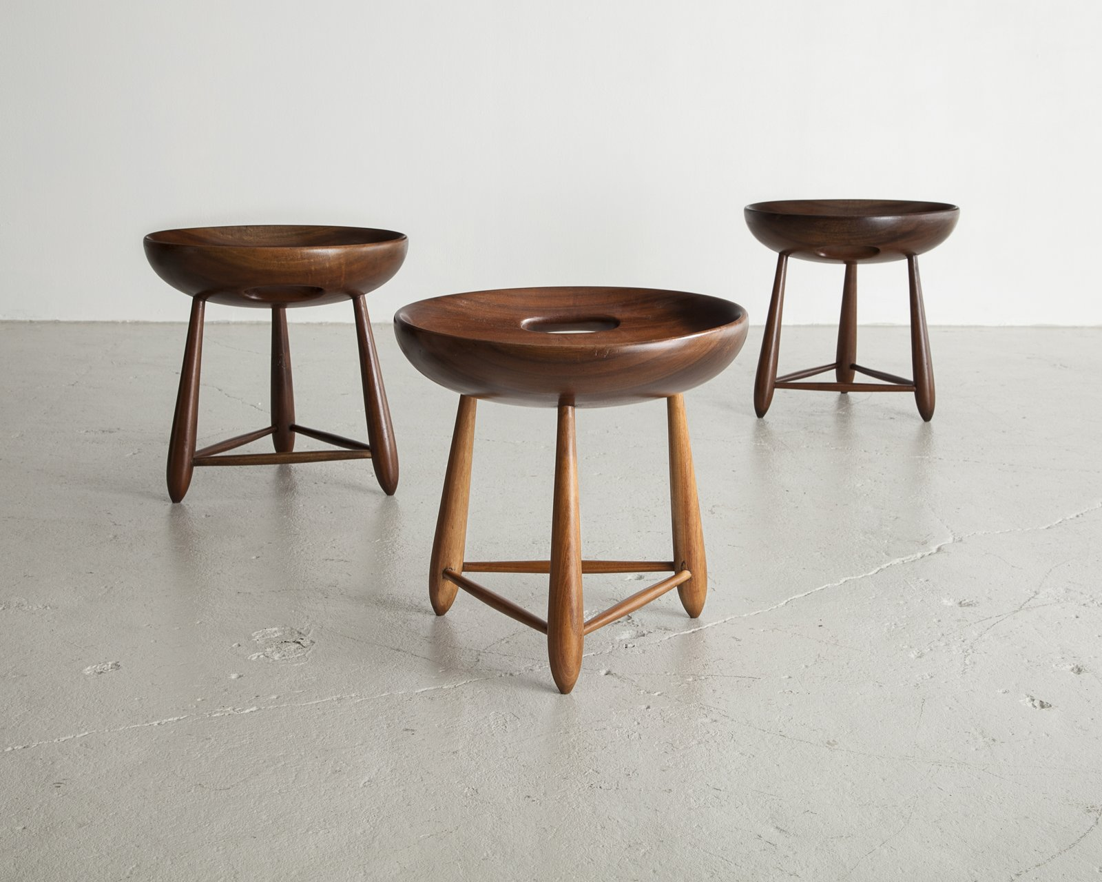 With signature materials like leather and wood, Sergio Rodrigues injected warmth and softness into his version of modernism. Here is a set of three-legged milking stools in Brazilian hardwood designed for Oca in 1954.  100+ Best Modern Seating Designs from Bring the Best of Brazilian Modernism to Your Home with This New Book