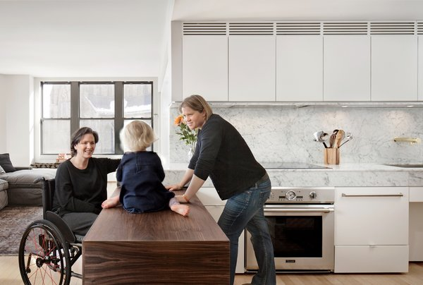 In renovating the 90-square-foot kitchen of a Boston apartment, architect Chris Greenawalt drew upon both spatial and material solutions to create a pleasing and wheelchair-accessible space to accommodate all three of its tenants.