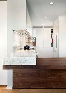 Greenawalt also clad the undersides of taller cabinets in marble to create an attractive aesthetic from every angle.