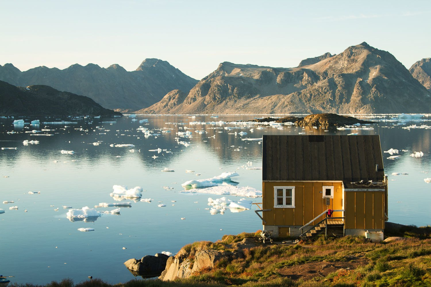 In Kulusuk, East Greenland, Haukur Sirgurdsson enjoys the reflections of a large lake speckled with floating ice chunks.  Seaside Escaping from Tour 8 Awesome Tiny Cabins Around the World