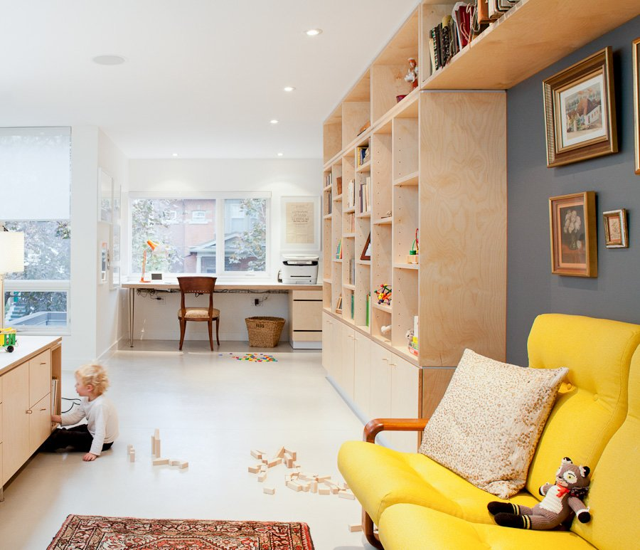 Custom birch millwork, fabricated by Toronto's Gibson Greenwood, defines a home office space on the second floor. Susan brought the yellow couch at right when she emigrated from Hungary in 1969.  Take Me to Birch: 8 Houses that Make Use of Birch Wood by Luke Hopping