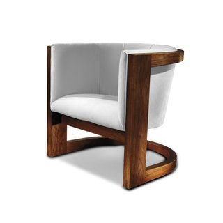 A steam-bent, solid wood frame seems to defy gravity in the Wendell Lounge chair.