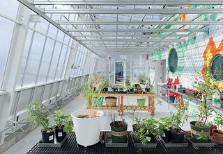 Pioneering chef Alice Waters has been converting schoolyards into spaces where children can grow plants and learn about making food since 1995. Her latest site, at P.S. 216 in Brooklyn, was designed by WORKac and is housed in a glass enclosure that features a greenhouse, raised beds, a chicken coop, and an indoor kitchen classroom. The structure channels runoff rainwater from its roof for reuse in the greenhouse.