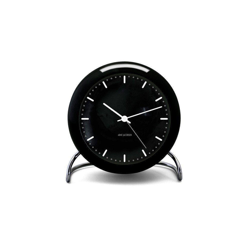 """When it comes to an alarm clock, Santos says, """"Just because it wakes you up every morning doesn't mean it has to be ugly. Make your alarm clock work for your schedule and your decor."""" Designed by Arne Jacobsen in 1956, the City Hall Alarm Clock is a companion to Jacobsen's iconic wall version, originally designed for the Rodovre City Hall building in Copenhagen.  Search """"classic danish nesting tables set"""" from Shop Homepolish's Favorite Products in the Dwell Store"""