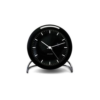 """When it comes to an alarm clock, Santos says, """"Just because it wakes you up every morning doesn't mean it has to be ugly. Make your alarm clock work for your schedule and your decor."""" Designed by Arne Jacobsen in 1956, the City Hall Alarm Clock is a companion to Jacobsen's iconic wall version, originally designed for the Rodovre City Hall building in Copenhagen."""