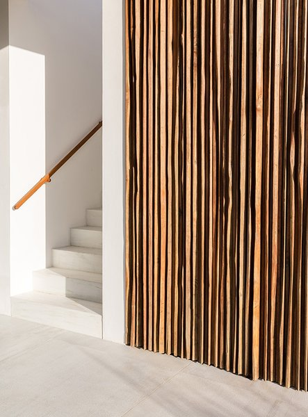 The interiors were designed by Landes's mother, Catalina Echavarria. Finding inspiration in Balinese craftsmanship, she incorporated materials like exotic salvaged wood, bamboo, rattan, and handmade linen.  190+ Best Modern Staircase Ideas