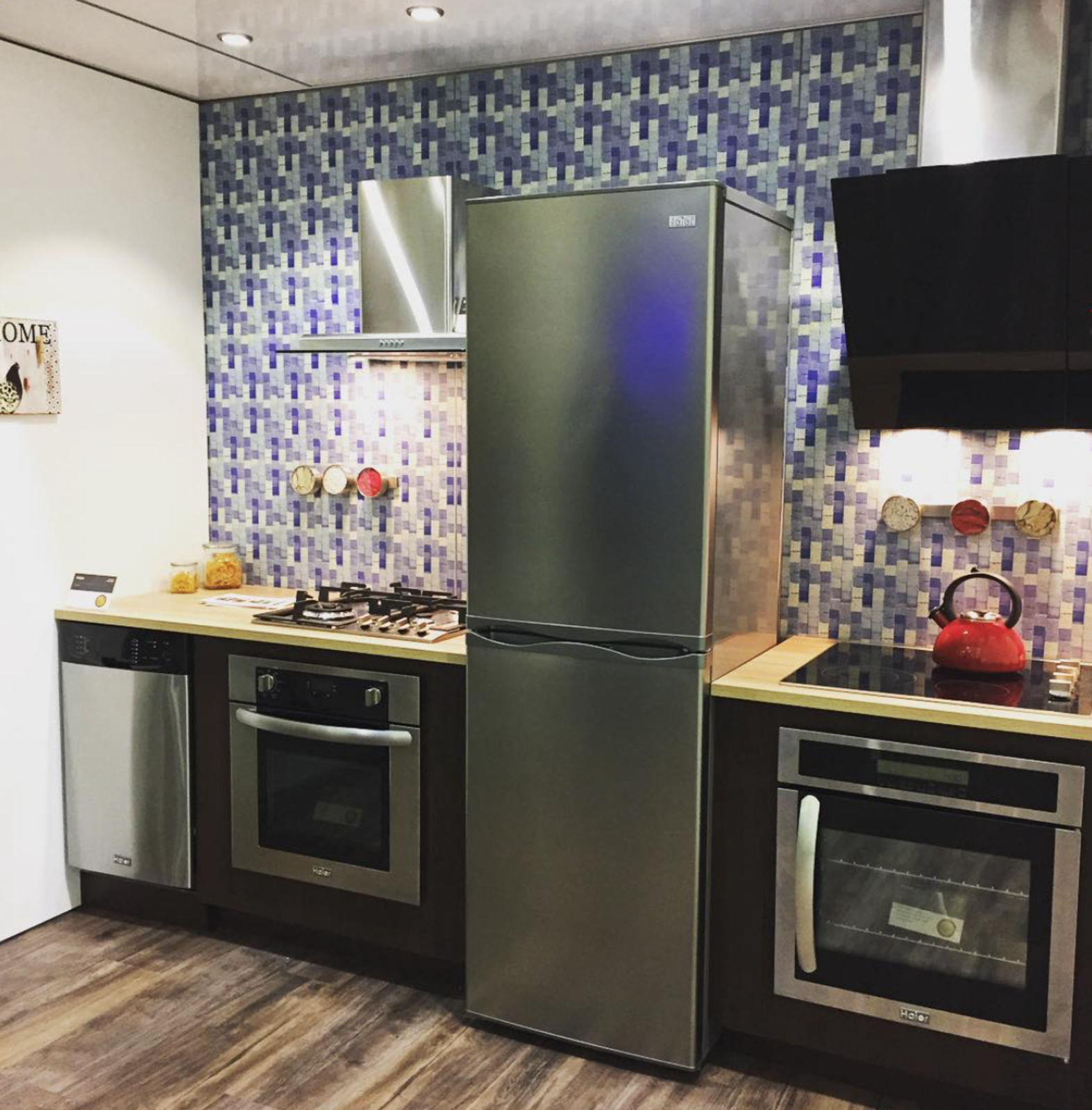 Haier shared a tiny kitchen with built-in, 24-inch appliances, perfect for small living in NYC.  Dwell on Design New York: Day One Highlights by Dwell