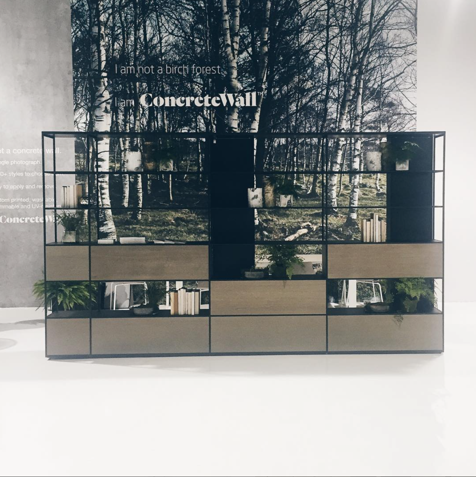 On display at Resource Furniture's booth, the La Literatura shelving system and a ConcreteWall covering adorned with a serene photograph of the Norwegian forest.  Dwell on Design New York: Day One Highlights by Dwell