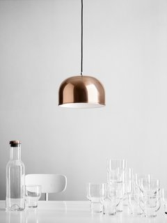 A closer look at the copper GM Pendant light, shown with Menu's stackable glasses.