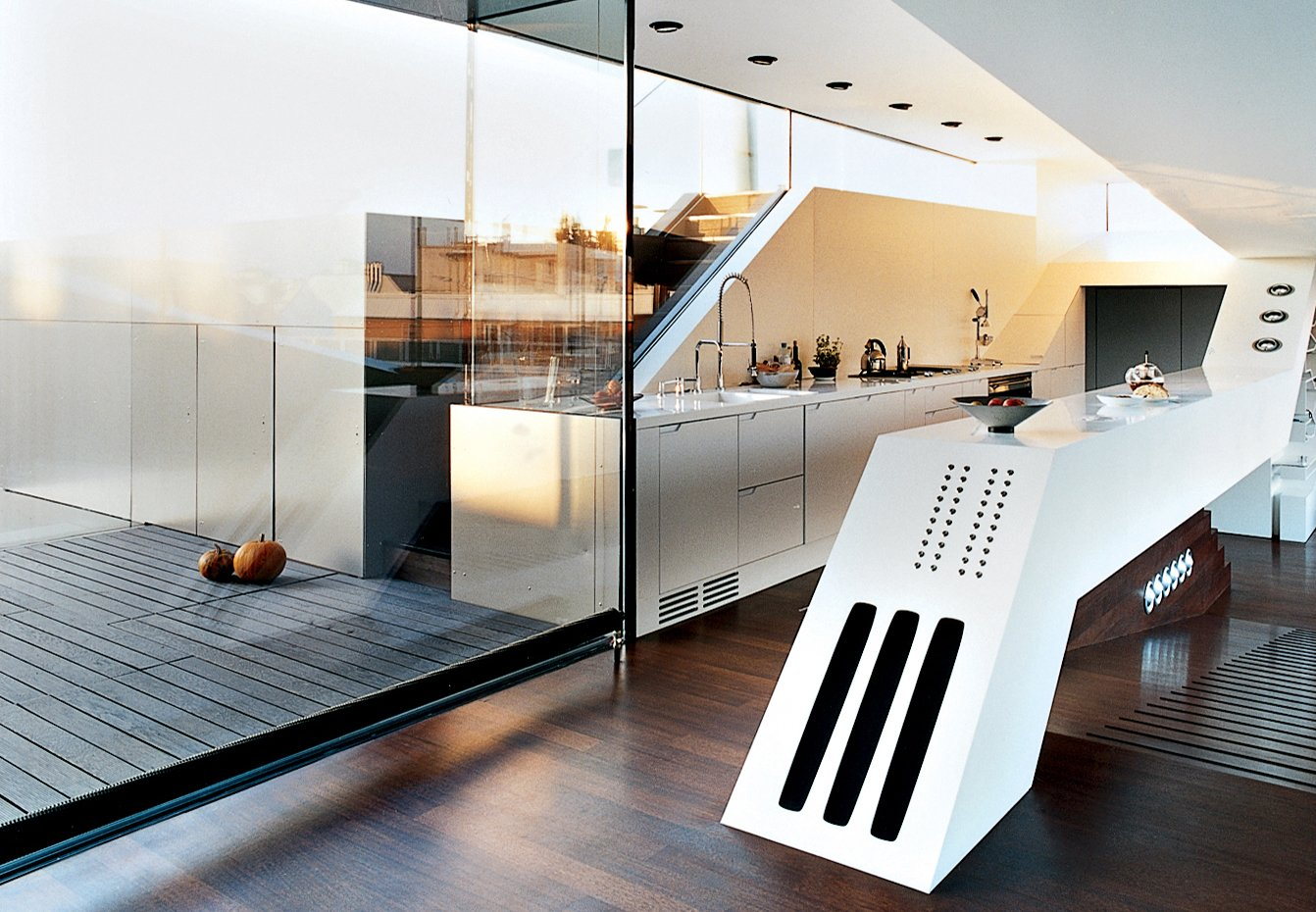 We award points for ingenuity, like this Vienna penthouse's kitchen counter that contains hi-fi speakers and a BUS-system panel of 18 buttons for controlling lights, curtains, heating, ventilation, etc.  Your Rooms We Love: Modern Countertop Inspiration by Kelsey Keith