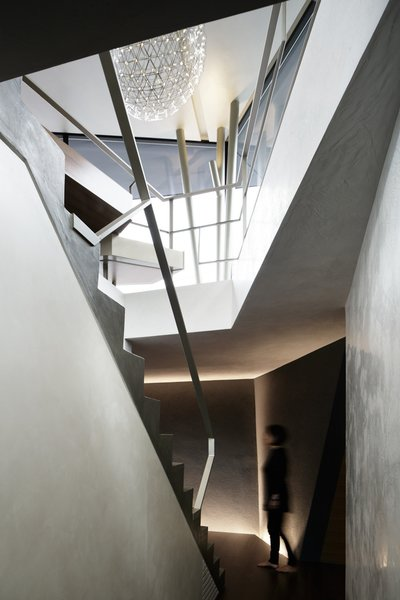 The challenge of building as angular a house on a 12 ft grade was visualizing how various vertical and horizontal planes would meet. The staircase serves as the backbone of the plan.  190+ Best Modern Staircase Ideas from SRK