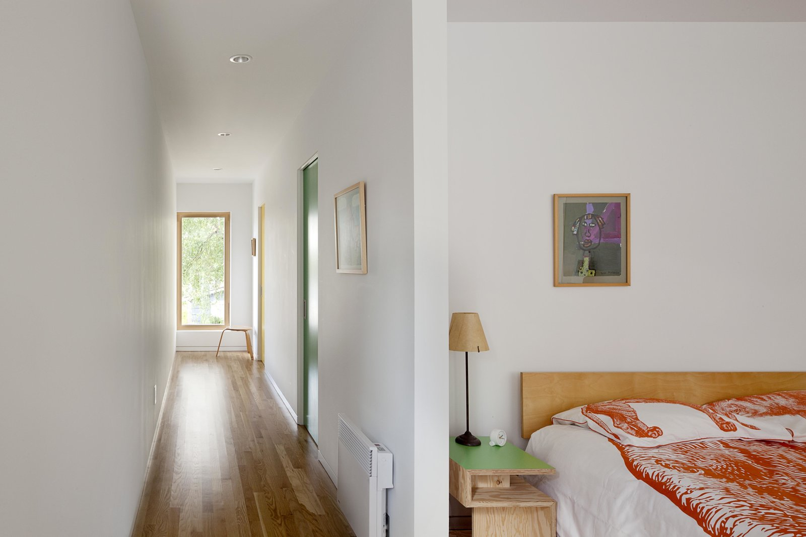 Bedroom, Bed, Table Lighting, and Night Stands Using scrap material from the kitchen cabinets and island, Stern and Chamblin created custom bedside tables that support a lamp by Seattle designer Brent Markee.  Bedrooms by Dwell from A Green Portland Home Built to Passive House Standards