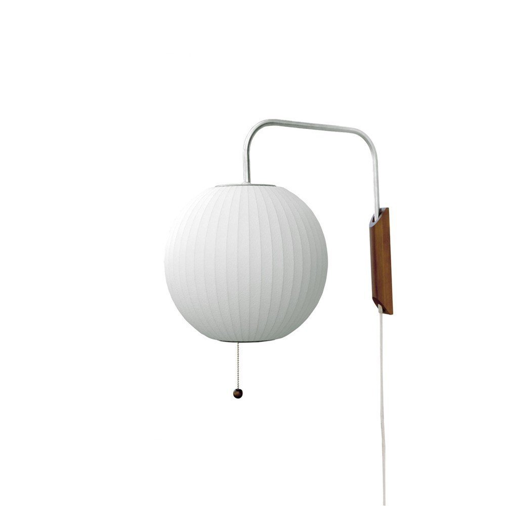 Rounding out the range of Bubble Lamps is Nelson's Ball Wall Sconce, which features a walnut wood wall mount.  Photo 8 of 8 in A Closer Look at the Iconic Bubble Lamp