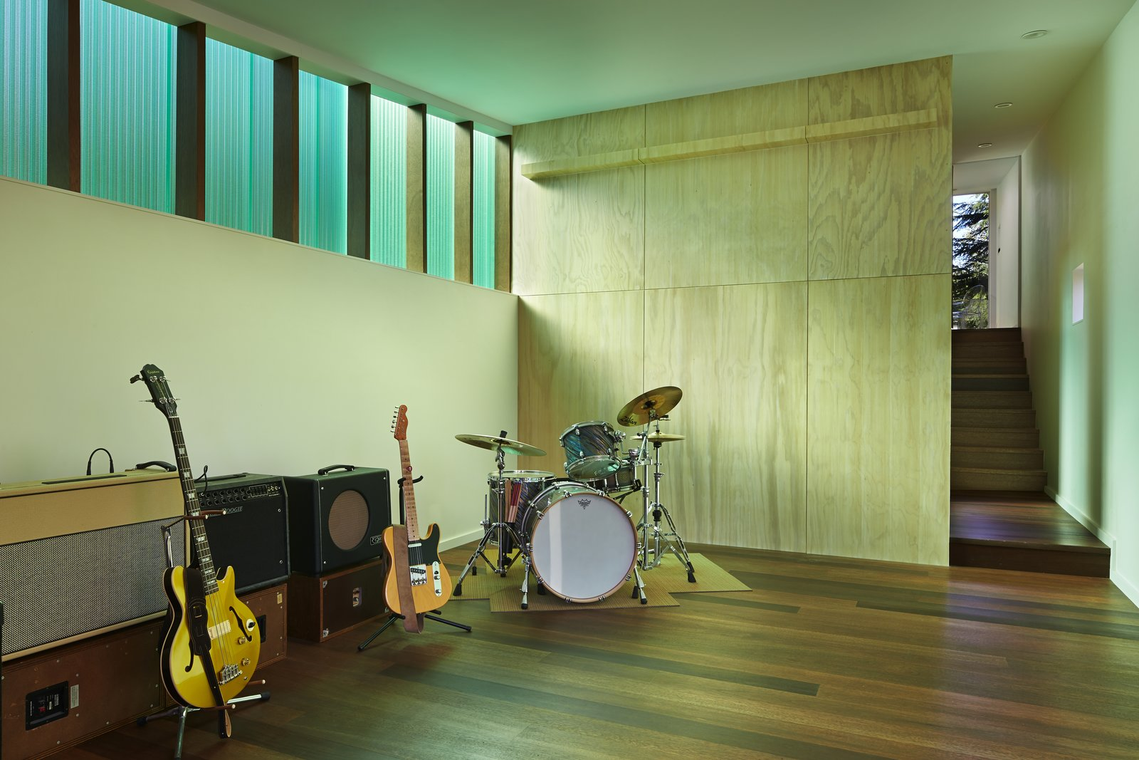 """Office The 1,000-square-foot studio includes a wood shop and music room. The Red Balau wood flooring was treated with Osmo color oil and Osmo Polyx finish. The walls are painted """"white heron"""" by Benjamin Moore.  Photo 5 of 10 in This Retreat in the Cascades is a Bold Take on the Modern Cabin"""