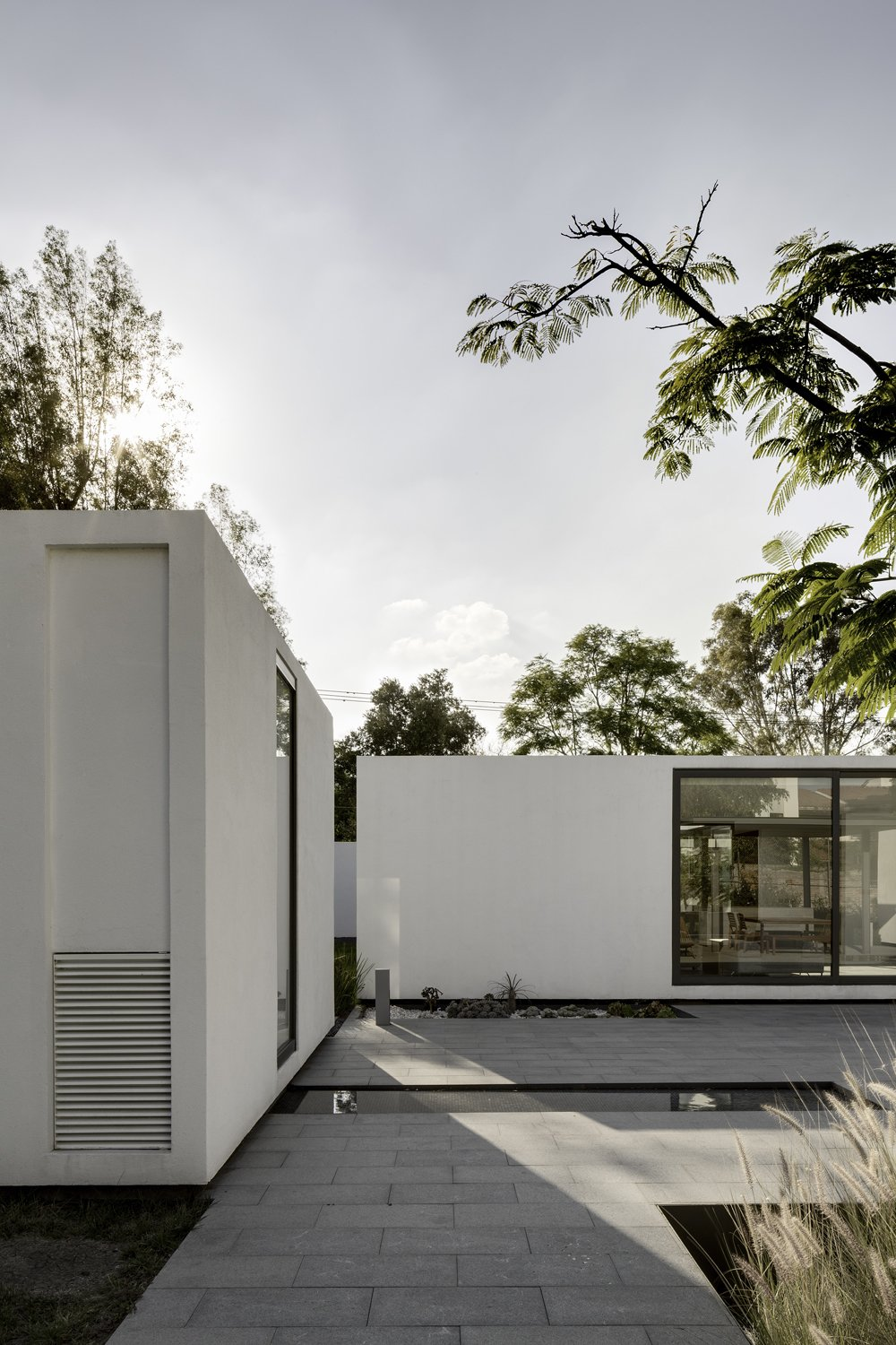 While it was AS/D's idea to create four separate masses instead of a central house, it was the residents who decided on the arrangement of those masses.  Photo 3 of 7 in A Minimalist Mexican Retreat Uses an Array of Strategies to Beat the Heat