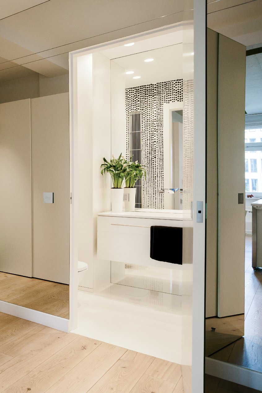 To make the space feel larger, Janiszewska decided to cover the hallway outside the bathroom with mirrors.  Photo 6 of 12 in This Tiny Warsaw Studio Instantly Changes from Office to Playroom