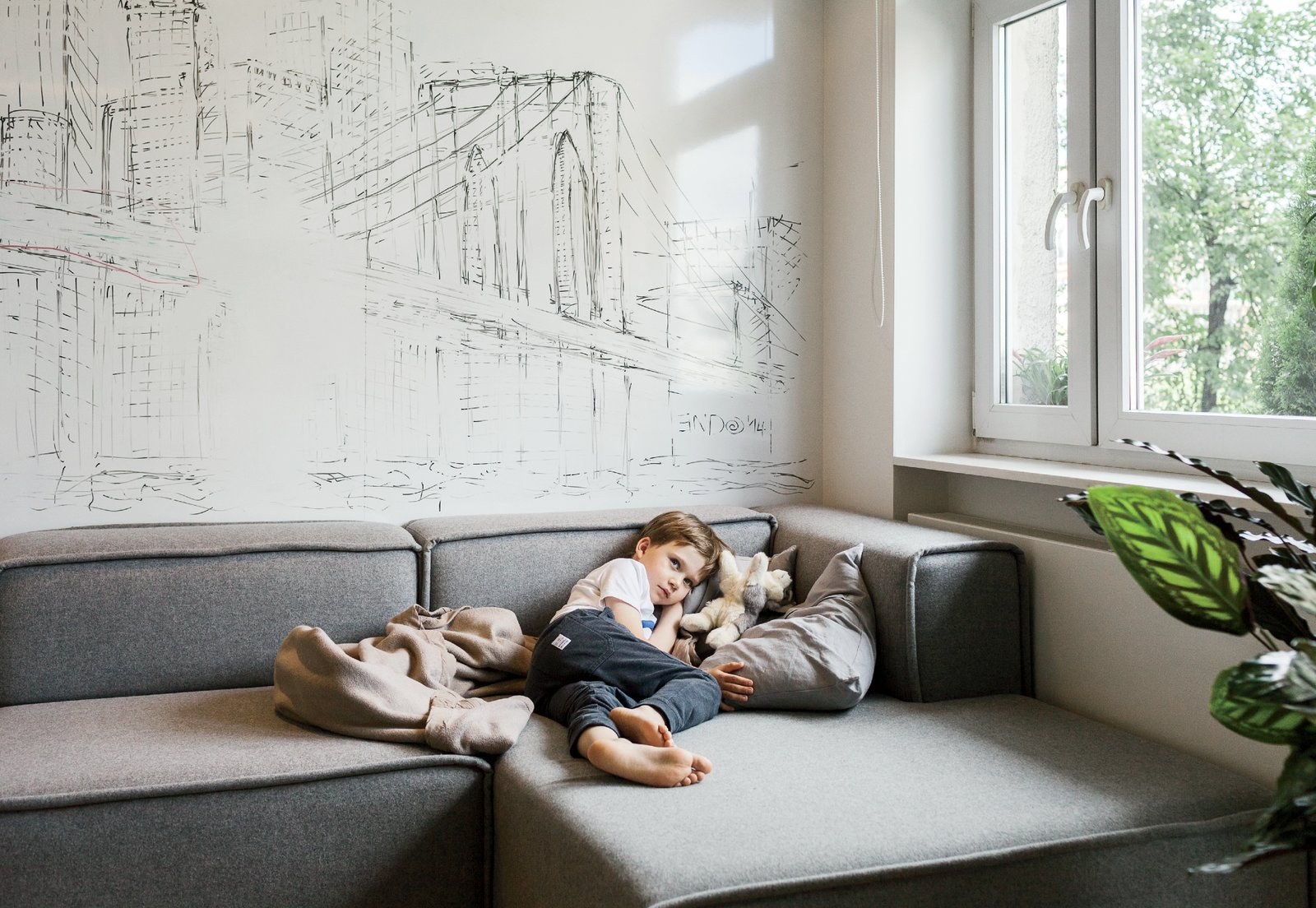 The modular Carmo sofa from BoConcept, ideal for naps and watching TV, can also be reconfigured as needed.  Photo 11 of 12 in This Tiny Warsaw Studio Instantly Changes from Office to Playroom