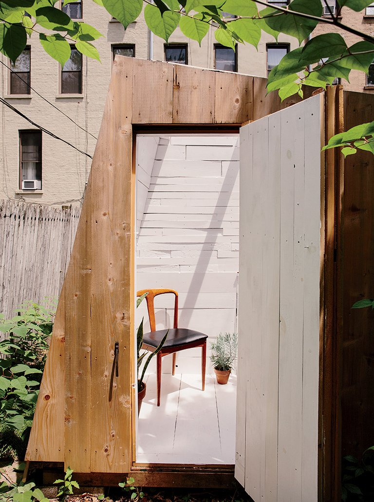 The building's design was determined by the desire for a strong geometric form and by the materials Hunt could find. The cedar cladding is meant to fade over time.  Photo 2 of 5 in An Architect Builds His Own Backyard Oasis From Salvaged Materials