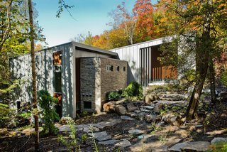 A Tranquil Lakeside Abode in Quebec Unfolds Over Six Levels