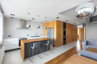 The renovation, which focused on the living-dining-kitchen area, strikes a balance between intimate and inviting, hence the project's name, the Open/Private apartment.