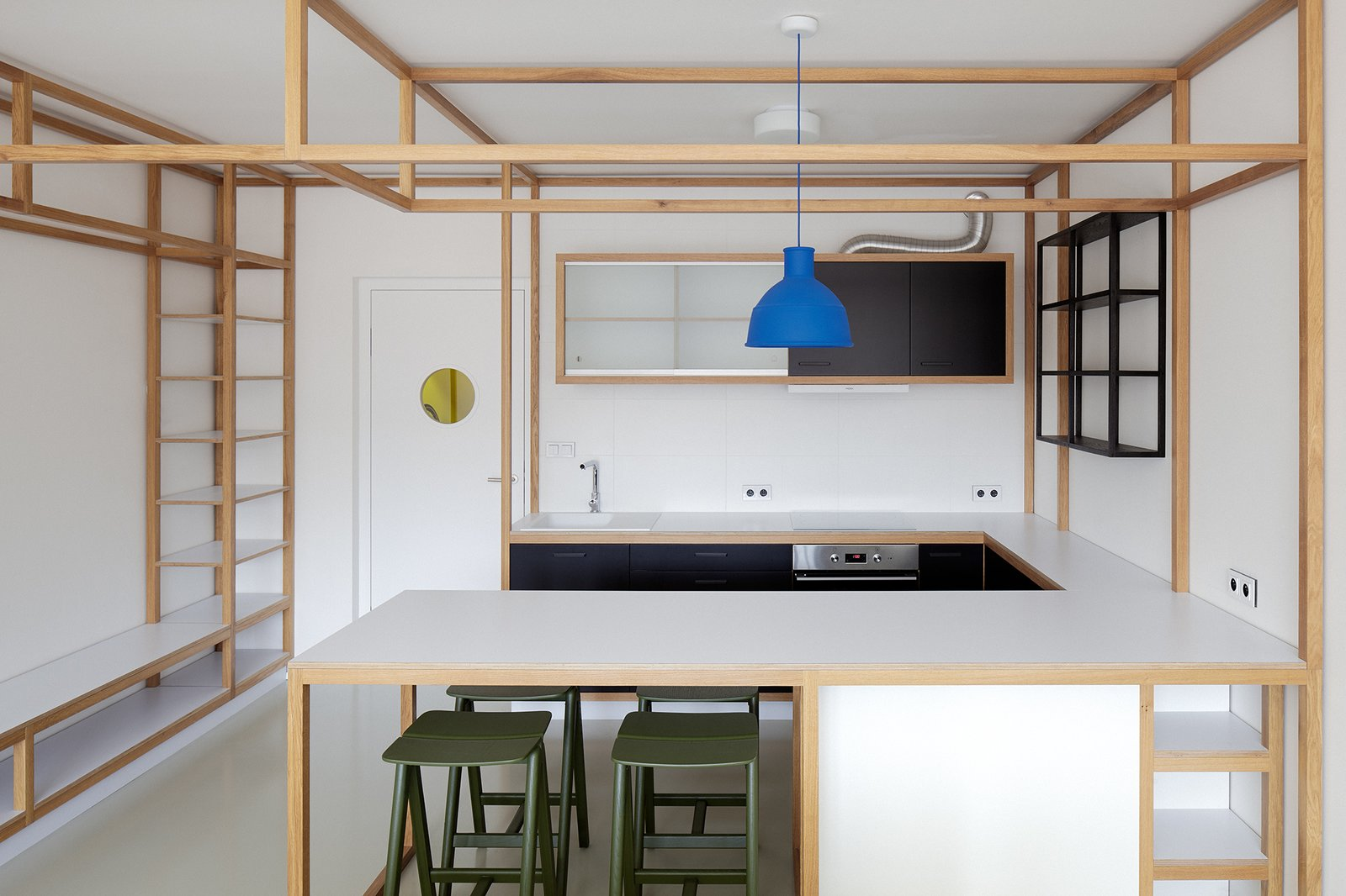 Kitchen, Laminate Counter, Pendant Lighting, Concrete Floor, Cooktops, and Drop In Sink The kitchen appliances are by Mora and the sink is by Franke.  Photos from Strikingly Minimal