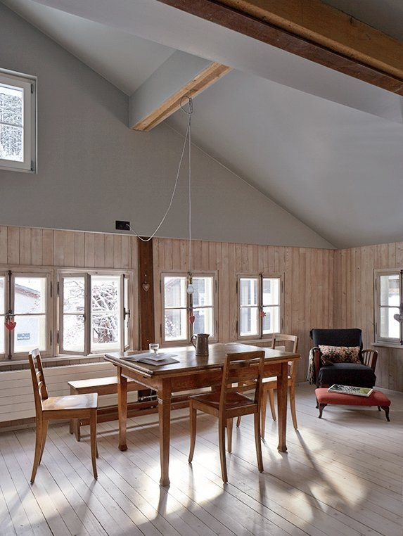 """The space """"is a contrast in scale with the rest of the house,"""" notes Tuckey, who added a super-insulated roof he says works """"like a woolly hat.""""  Photo 7 of 12 in A Sliced-Up House Comes Together Again"""