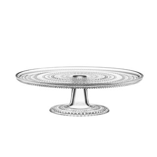 "Designed by Oiva Toikka for Iittala, the Kastehelmi series is now an iconic product line within the brand. Finnish for ""dewdrop,"" the Kastehelmi evolved from a technical challenge—Toikka used the glass droplets to cover joint marks left on the surface of pressed glass pieces. The Kastehelmi Cake Stand features the iconic dewdrop design, and can either be used for presenting cakes and desserts or as an unexpected display for candles, flowers, and other accents."