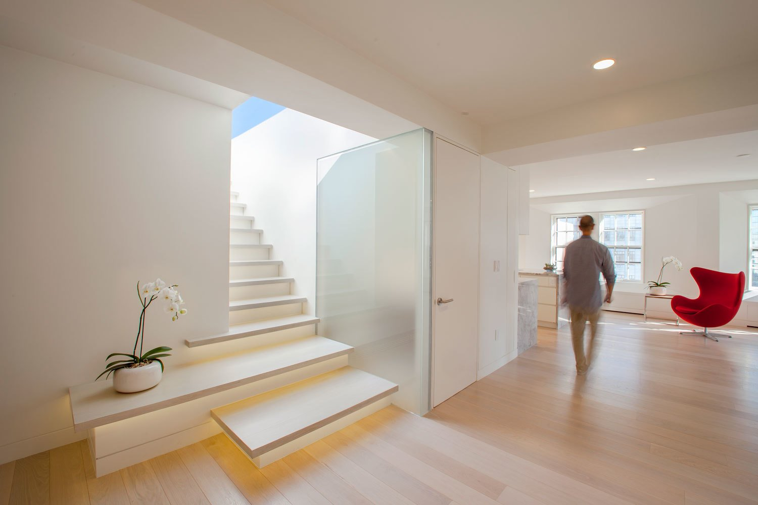 A post-war penthouse in Boston, the Perimeter Loft was given a sleek transformation that favors natural light. A stairwell leads to a roof deck.  Architecture Firm You Should Know: Höweler + Yoon by Allie Weiss
