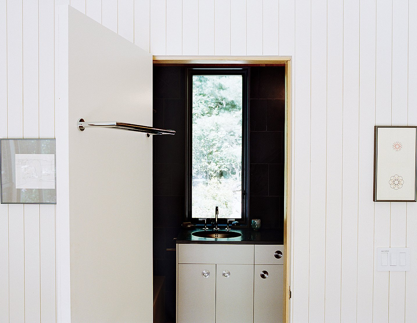 Bath Room The bathroom is outfitted with a Kohler sink, black tile, and a countertop from Williams & Sons Slate & Tile.  Photo 6 of 12 in This Tiny New England Cottage Is a No-Frills Weekend Hideaway