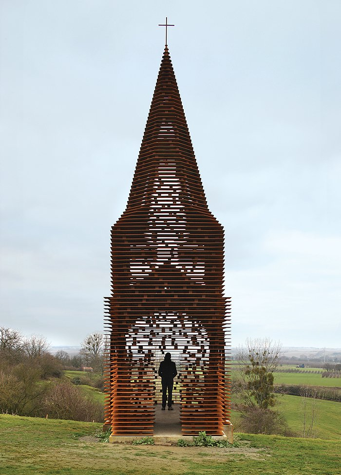 The Belgian firm Gijs Van Vaerenbergh constructed a see-through steepled chapel in Cor-Ten steel in 2011.  Photo 13 of 21 in You Won't Believe That These Incredible Modern Buildings are Chapels and Synagogues