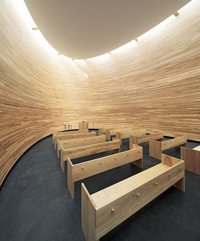 Known as the Chapel of Silence, the skylit, curved wooden structure is designed for quiet meditation.  Photo 17 of 21 in You Won't Believe That These Incredible Modern Buildings are Chapels and Synagogues