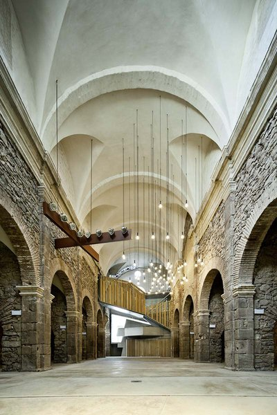 Careful not to downplay the space's history, several traces of its former disrepair—such as inconsistencies in the original walling—remain on full display.  Photo 21 of 21 in You Won't Believe That These Incredible Modern Buildings are Chapels and Synagogues