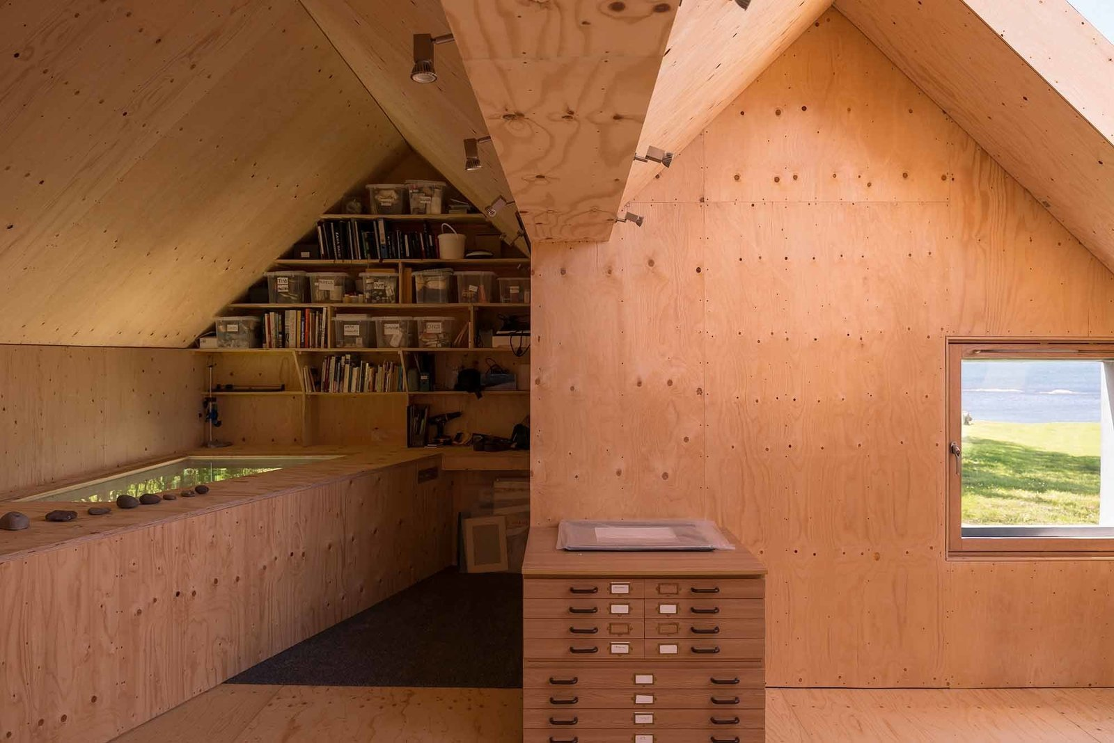 The studio's double-pitched roof is a nod to the traditional local architecture.  Midden Studio by Sarah Akkoush