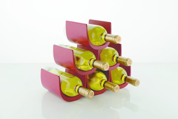 The Noè Modular Bottle Holder from Alessi was originally inspired by the image of a bunch of grapes. The sculptural bottle holder was designed to be a functional accessory—it holds six bottles of wine—as well as a decorative accent for a countertop, floor, or wall. The modular system can be combined with other Noè bottle holders to create a large graphic display, or can be used individually for a more subtle effect.