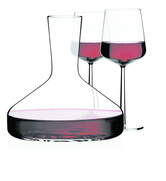 The perfectly formed, mouth-blown shape of Citterio and Nguyen's Decanter for Iittala was thoughtfully designed to enhance the qualities of its contents. The neck opens slightly, allowing wine to breathe and releasing the flavors and bouquet that have been locked inside it. The clean, clear design lets in light to ignite the brilliant color of wine. Shown with Iittala's Essence Glassware, designed by Alfredo Häberli.