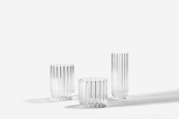 Like Felicia Ferrone's earlier Margot glassware collection, the Dearborn Collection of glassware is designed to take traditional glassware and reinvent it with intricate details. Each piece of the Dearborn collection is made without the use of molds and is comprised of fluted Boroscilicate glass. The champagne flute, wine glass, and water glass are each expertly handcrafted by master glassblowers in the Czech Republic.