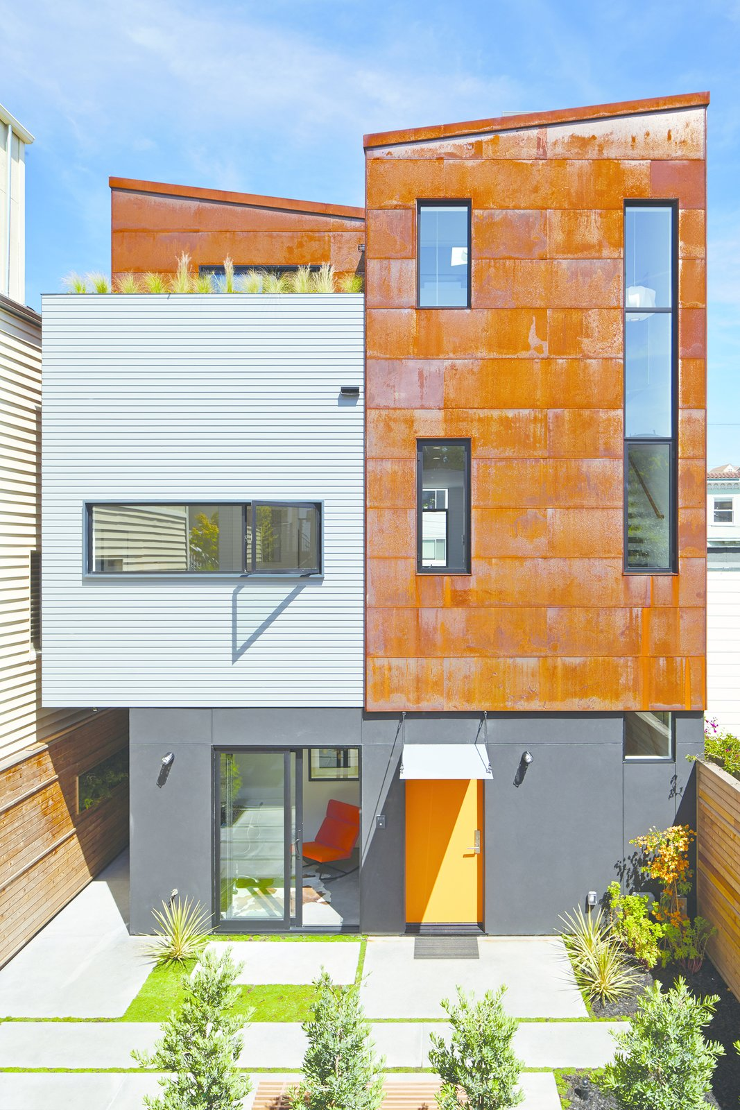 """We are always interested in doing unapologetic modern design in an architecturally conservative city,"" Zack says. The front unit's door to the courtyard is painted in Sherwin-Williams' ""carnival"" shade.  San Francisco Renovations We Love  by Matthew Keeshin from A San Francisco Renovation Creates Two Apartments from One"