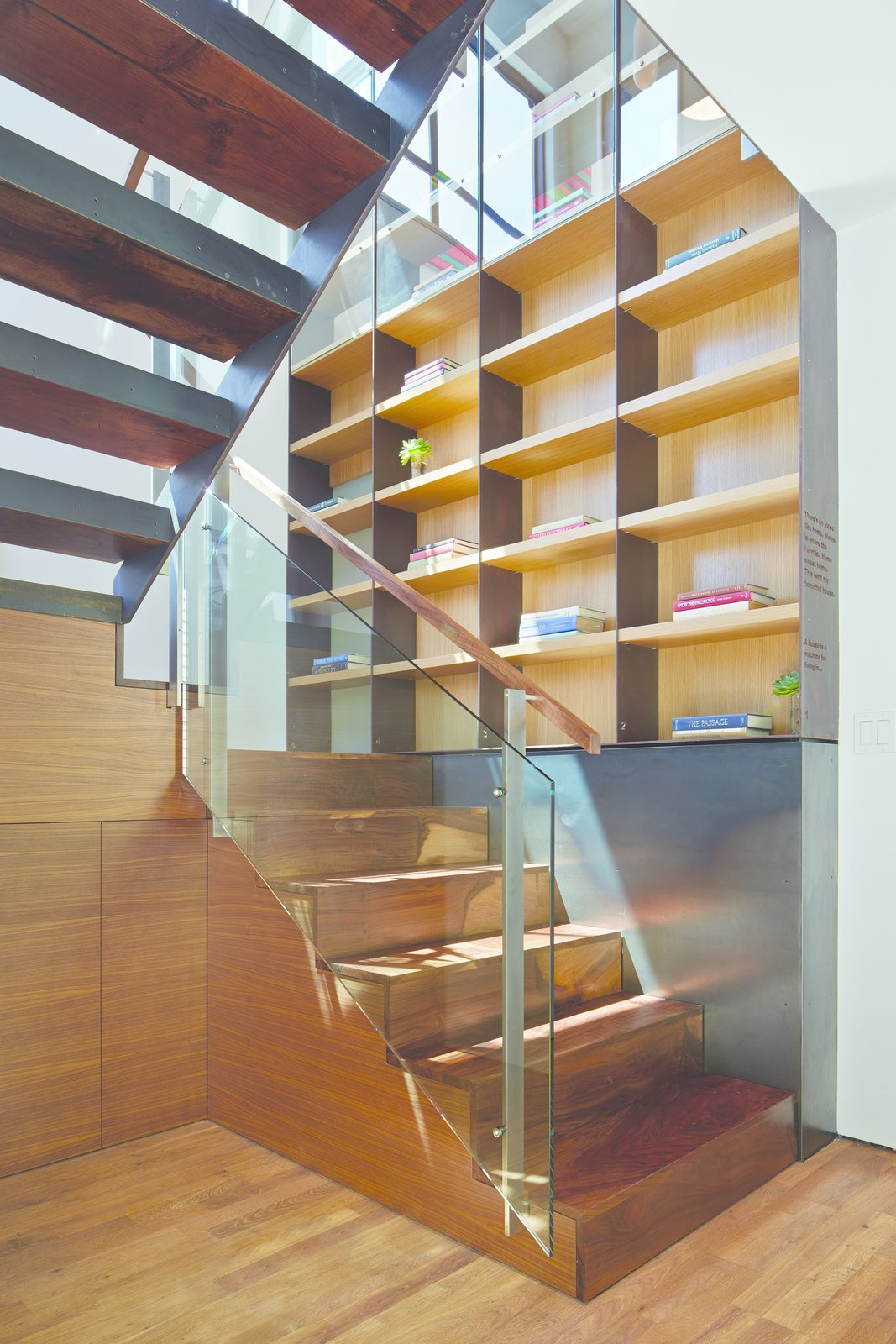 """""""The rear unit was about 90 percent rebuilt,"""" Zack says. """"We added a full floor of living space in what was the garage."""" Black walnut was used to make the home's stairs and handrails.  190+ Best Modern Staircase Ideas from A San Francisco Renovation Creates Two Apartments from One"""