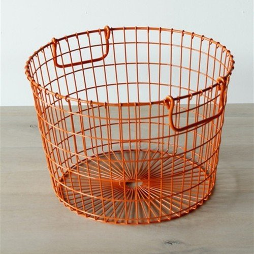 The Wire Potato Basket from Lostine is inspired by old potato farming baskets, matching the silhouette, sturdiness, and functional handles with a colorful twist.